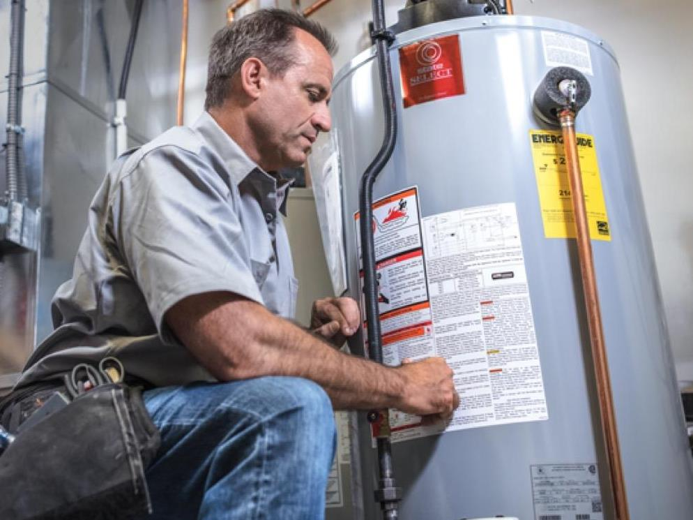 Superior Propane employee servicing a water heater.