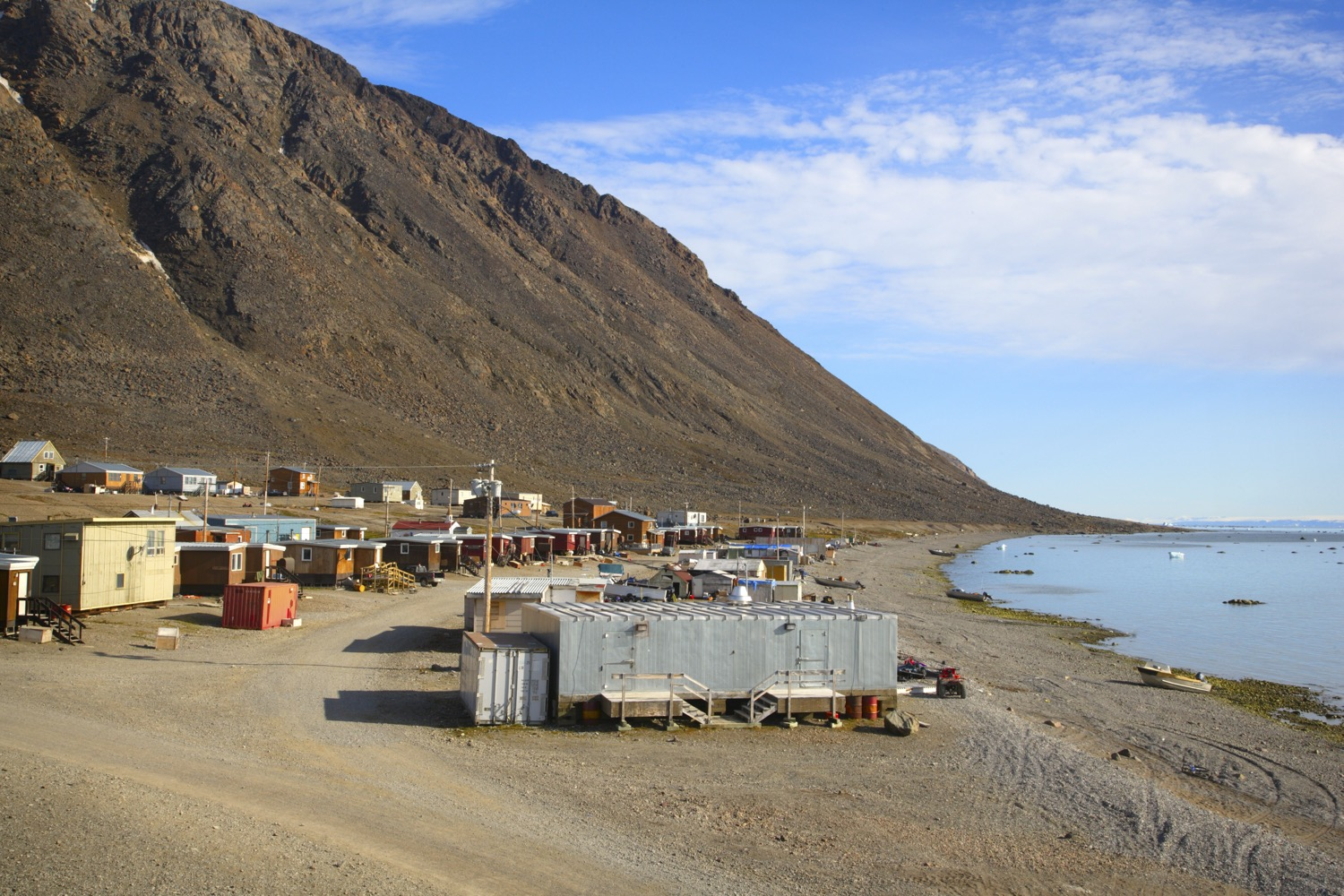 Small town next to the mountains and lake in Nunavut.