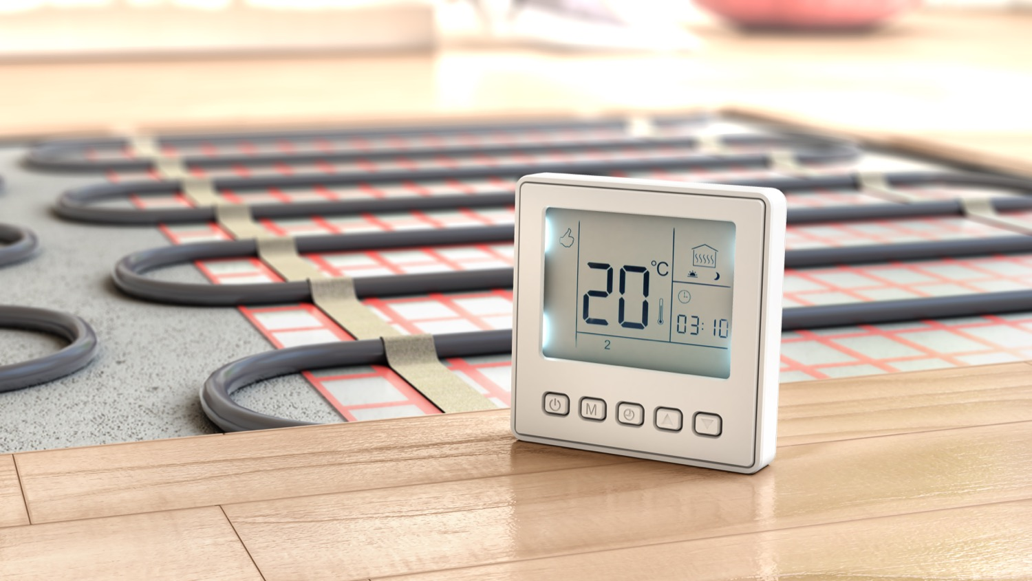 A thermostat on the floor next to an exposed radiant floor heating system.