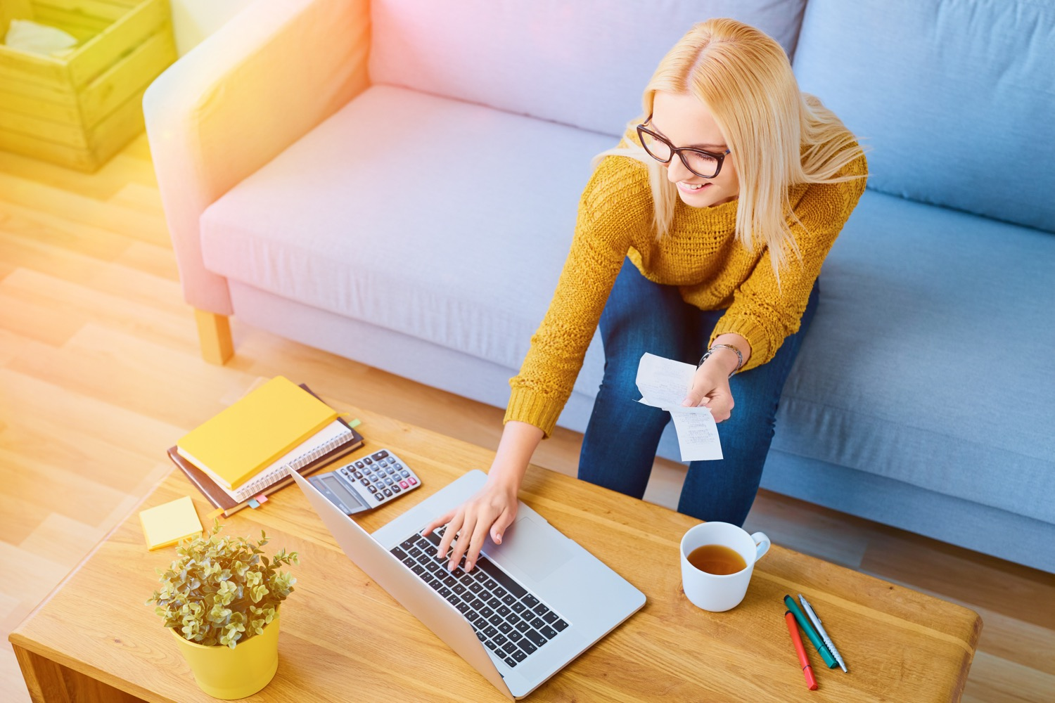 res_woman-paying-bills-on-laptop_adobestock_110854650