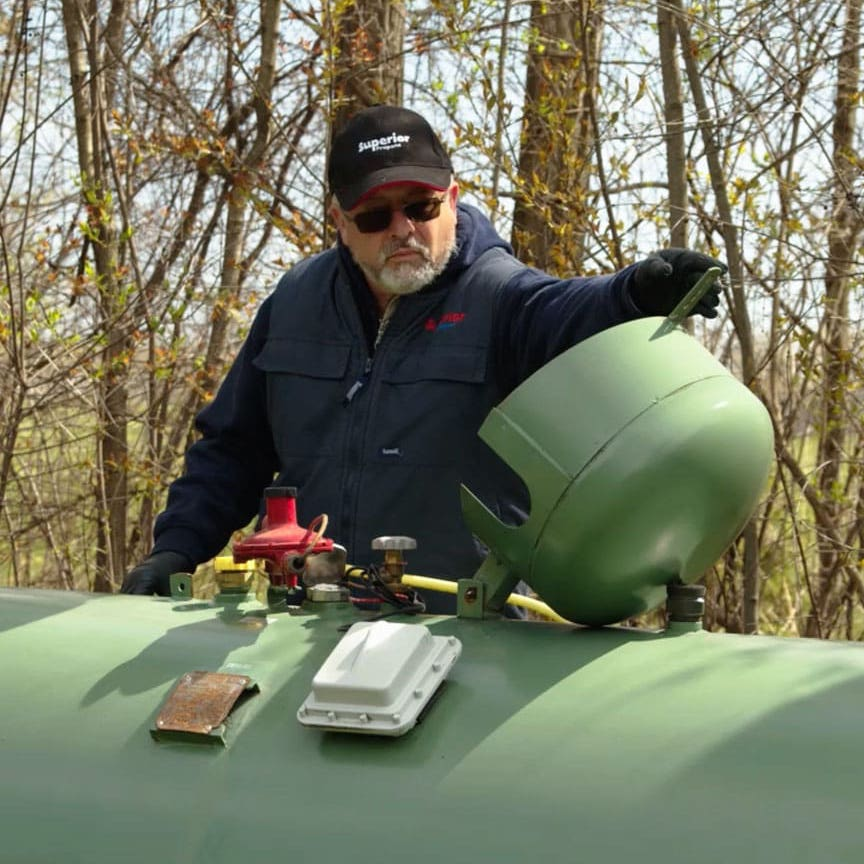 Superior Propane employee installing a new tank.